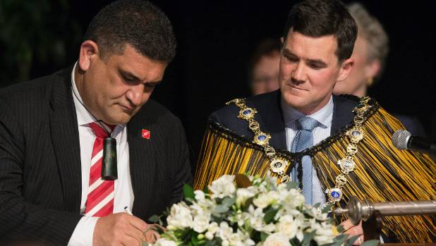 Wellington's new deputy mayor Paul Eagle signs a formal declaration at the council's inauguration ceremony, as new mayor ...