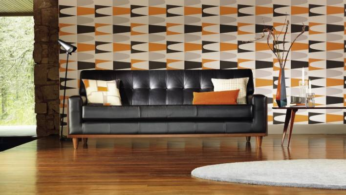 The 59 leather sofa by G Plan Vintage, from Karakter, is shown in Capri Black.
