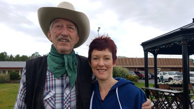 Leeanna posing with a cowboy in Bozeman, in the US state of Montana, where her 15 romance novels are set.