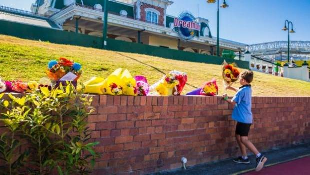 Bouquets are now being left at Dreamworld in memory of the four victims.