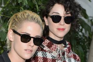 Kristen Stewart and St Vincent make their public debut as a couple at a Vogue party.
