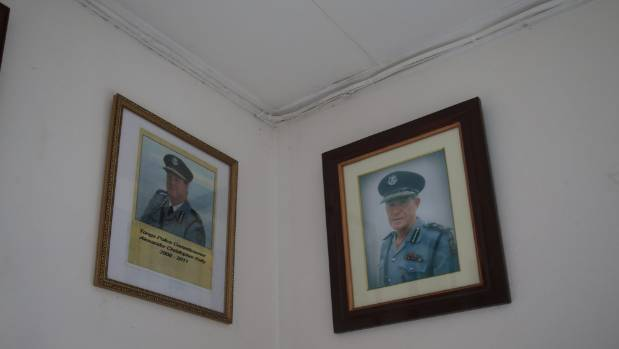 The pictures of former Tongan police commissioners Chris Kelley, left, and Grant O'Fee hang on the wall at the Police ...