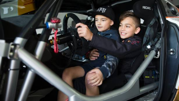 Lincoln Whiddett, 8, and Ryder Quinn, 11, dream of racing cars.