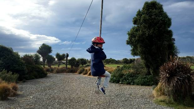 Boy plays in abandoned playground: An argument for housing is that it brings life back to the area.