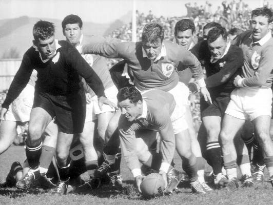 French half back Pierre Lacroix gets challenged by Colin Meads, left, and Dennis Young at this Christchurch test in 1961.
