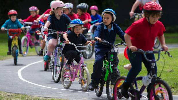 Terrace End School pupils celebrate the official opening of their bike tracks.