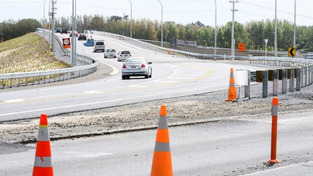 Traffic gets a run over the new Peka Peka overbridge, which has been built as part of the Mackays Crossing to Peka Peka ...