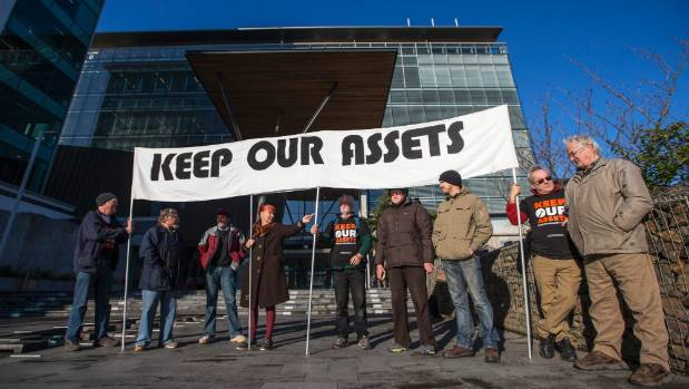 "Protesters gather outside the Christchurch City Council with their banner, ""Keep Our Assets"", during past action."