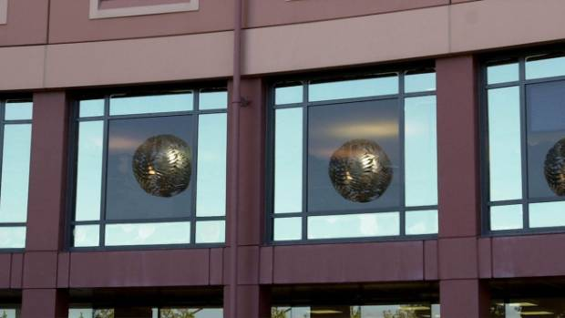 Reflections of Neil Dawson's Ferns in the windows of the offices of the Wellington City Council building at Civic Square.
