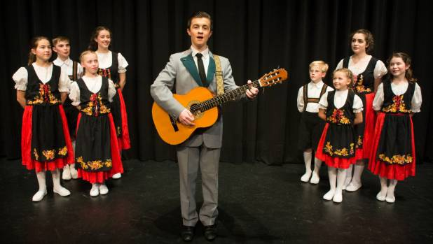 Captain Von Trapp (Sam McIlroy) performing in the concert with his family before fleeing Austria, from Nelson Youth ...