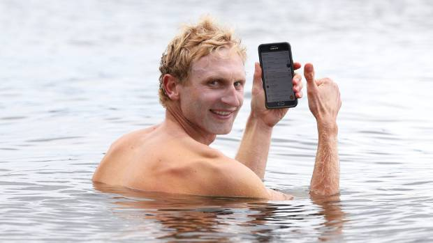 Olympic gold medal winning rower Hamish Bond takes a dip in Lake Te Anau after stage three of the 2016 Tour of ...