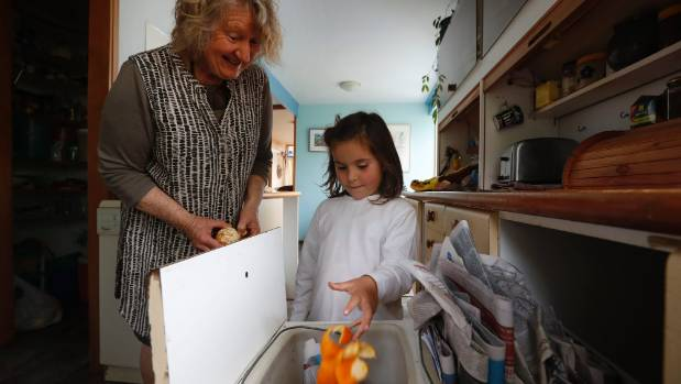 Sarah Langi and her grand dauaghter Florence Langi-Short with her recycling and compost bins in her Nelson home.