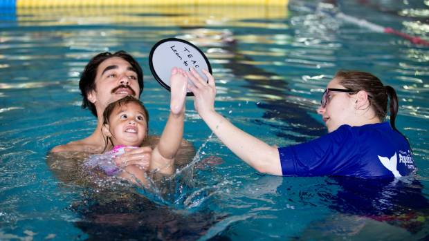 Swimming Coaches Encourage Dads And Their Water Babies