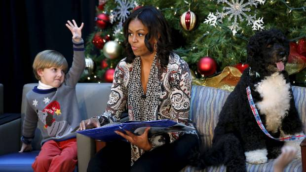 "Michelle Obama in 2015, continuing a 60-year old tradition of reading ""The Night Before Christmas"" to sick kids in ..."
