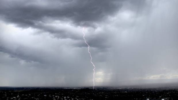 A view of lightning striking the central city from Huntsbury Hill.