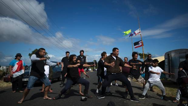 People gathered to occupy land at Ihumatao prior to cultural, archeological and historical areas being developed for housing.