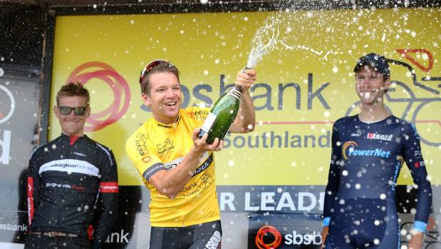Tour of Southland winner Aaron Gate celebrates by spraying the champagne.