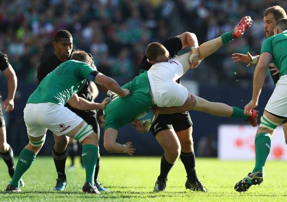 All Blacks prop Joe Moody performs an illegal lifting tackle on Ireland's Robbie Henshaw. Moody would go to the bin for ...