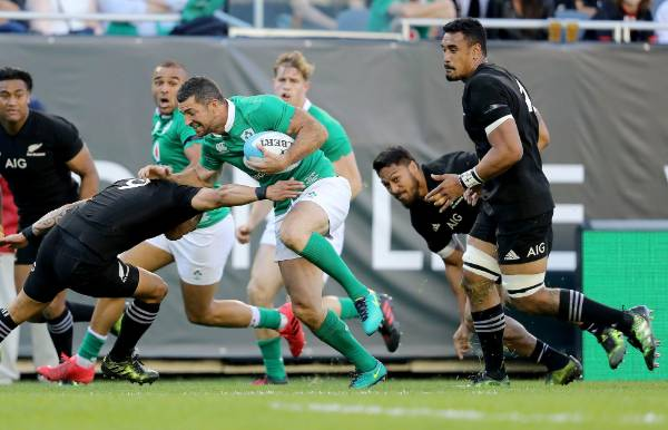 Ireland's Rob Kearney carries the ball against the All Blacks at Soldier Field.