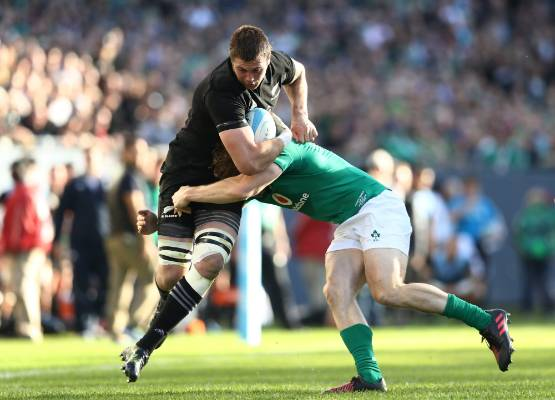 All Blacks flanker Liam Squire charges down the sideline in the Soldier Field test against Ireland.