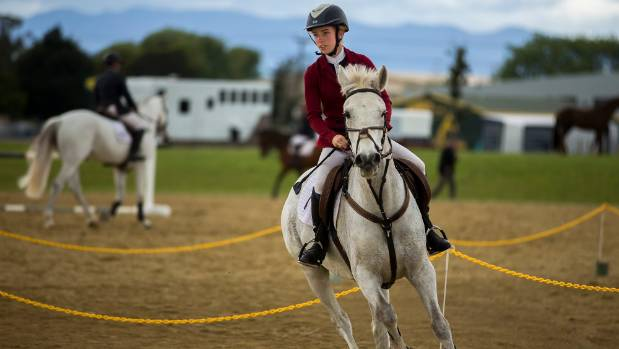 Ellen Davis rides Tallyho Mozart in the horse riding competition.