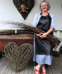 Deborah Walsh with willow wands she uses for her woven hearts and animals.