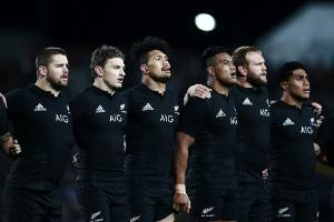 The All Blacks love singing the national anthem before their games. As is obvious in this picture.