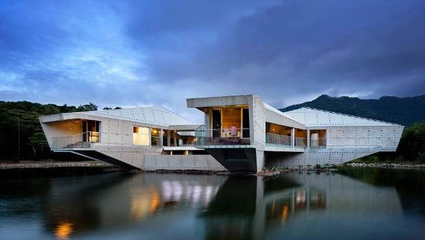 Alkira, designed by renowned architect Charles Wright, appears to float upon the water in the midst of the Daintree ...