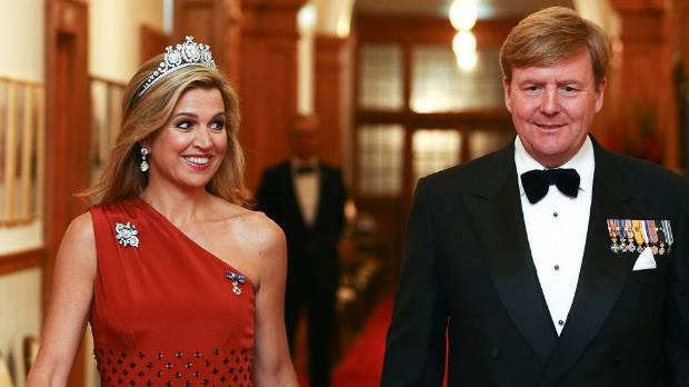 King Willem-Alexander and Queen Maxima of the Netherlands arrive during a state dinner at Government House.