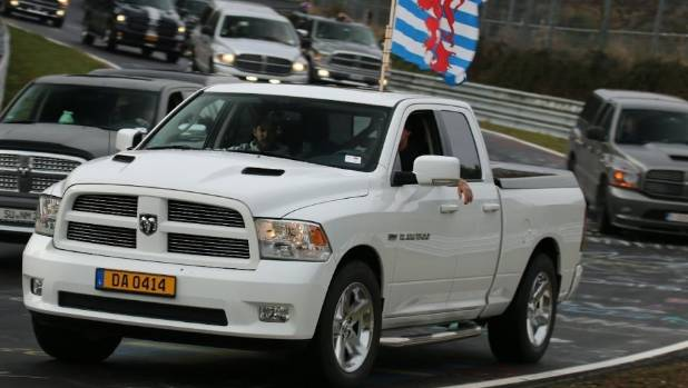 Ram trucks wind their way around Nurburgring during a world record gathering for trucks and utes.