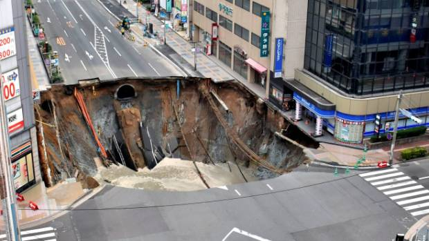 The 27m-wide sinkhole opened up at an intersection in the city centre of Fukuoka, Japan.