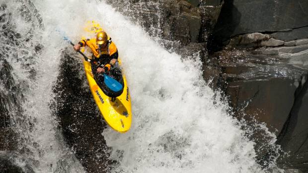 Paul Currant on the first rapid after being dropped off by chopper at the top of the Upper Waitaha River