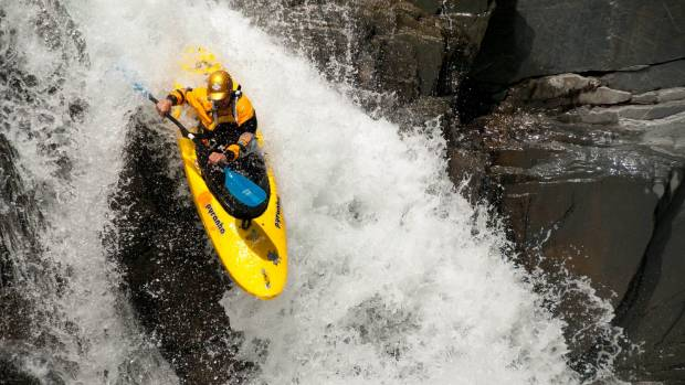 Paul Currant on the first rapid of the Upper Waitaha River after being dropped off by chopper at the top of the river.