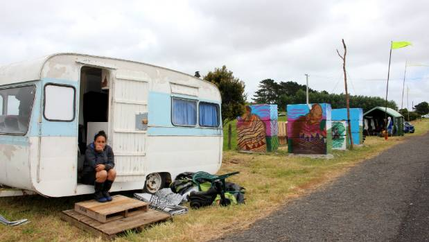 Pania Newton sitting in her caravan parked on the side of the road.