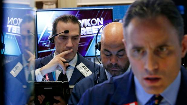Traders work on the floor of the New York Stock Exchange on election day.
