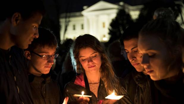 People gather for an anti-Donald Trump candlelight vigil in front of the White House.