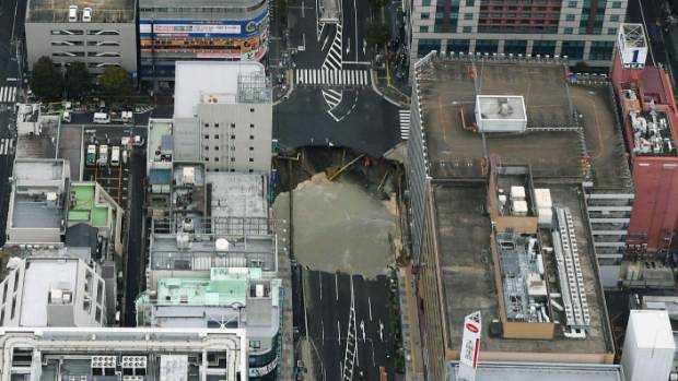 Big sinkhole swallows road in Japanese city