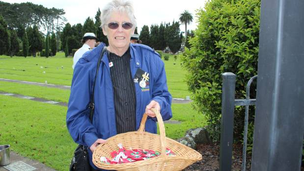 Lesley Guptill gives out poppies as part of last year's ANZAC Day celebrations.