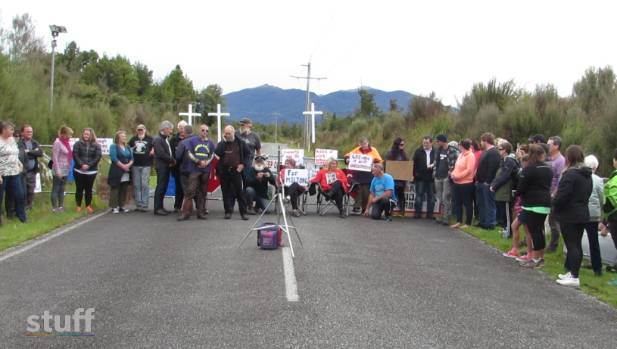 Family members of men killed Pike River mine disaster protest sealing of mine