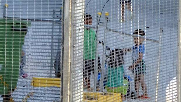 A photo from Amnesty International claiming to show children playing near a fence at the Australian-run detention centre ...