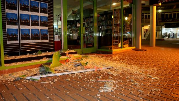 Smashed glass and shopfront damage in central Blenheim.