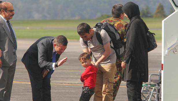 Immigration minister Michael Woodhouse welcomes Afghan refugees to New Zealand in 2013.