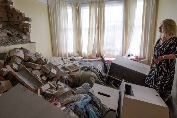 Historic Waiau Pub co-owner Michelle Beri  looks over the damage to her bedroom, grateful that she was not sleeping in ...