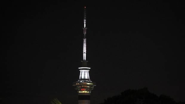 Auckland's Sky Tower lit up black and white in support of those affected by the earthquakes.