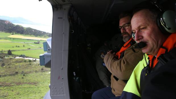 Prime Minister John Key inspects earthquake damage north of Kaikoura from an RNZAF helicopter on November 14, 2016 in ...
