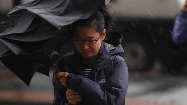 Wellingtonians are battling stormy weather and torrential rain, as well as the after effects of Monday's earthquake.