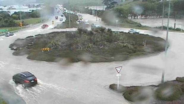 The centre of the Paramata roundabout pokes up above the floodwaters.