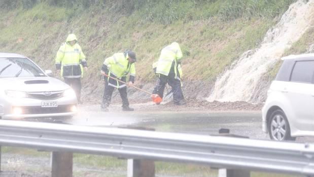 Police clearing slip SH1 motorway south near Tawa, Wellington.