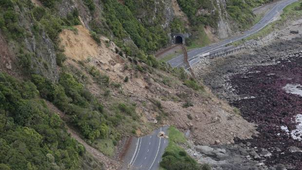 Huge slips, caused by the 7.5 earthquake, are seen blocking State Highway 1 north of Kaikoura on Tuesday.