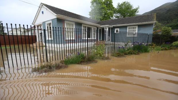 A Lower Hutt house is caught by flood waters after the Waiwhetu stream burst its banks.
